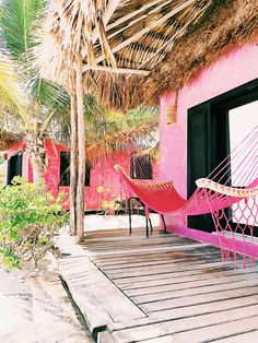 pink straw roof hut with pink hammock in belize. / sfgirlbybay