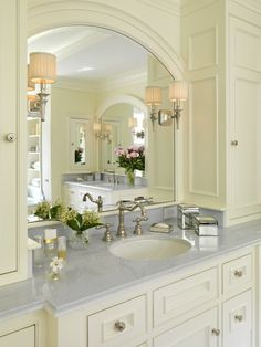 Suzie: Jan Gleysteen Architects - Sweet ivory bathroom with twin ivory bathroom vanities with ...