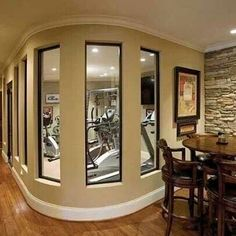 Home gym. In basement. Laundry room to the right of the table. Hallway, length of basement tothe left. Sauna directly opposite of table.