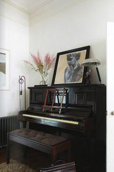 beautiful dark upright piano.  heartandhome