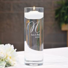 Personalized Elegance Floating Unity Candles. I love this candle it's so cute and elegant I'm getting this for my unity ceremony