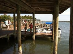 Not only can you eat, but you can rent kayaks and paddleboards at J.B.'s Fish Camp in New Smyrna Beach, FL