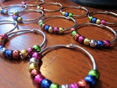 """For these rings, this blogger purchased 2"""" book rings (set of 12) from Office Max for $4.79 & some beads from Michael's for $2.49. But the Dollar Store has packs that may end of being a better buy. May be nicer than the pipe cleaner rings I made with St to have their own personal set. Could use these @ a Math Station."""