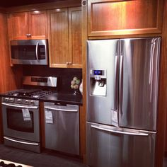 Samsung Kitchen Package at Gerhards Appliances ; couter depth french door refrigerator, 5 burner gas free standing range, fully intergrated dishwasher, and over the range dishwahser