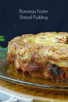 BANANAS FOSTER BREAD PUDDING ==Ingredients== 10 c dry bread, cubed (approximately 1 pound loaf of french, 2 c whole milk, 14 oz can sweetened condensed milk, 3 eggs, 1 T vanilla extract, 1 t butter extract, ⅛ t salt, ½ t cinnamon, 5 bananas cut into 1 inch slices, 1 c brown sugar, ½ c butter - no substitutions, 4 T rum, 1 c chopped walnuts or pecans (optional) ====