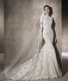 Vestido de novia con bordados de encajes de cuello alto, detalles de bordados en toda la silueta. Una opción perfecta para una novia romántica.