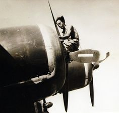 Lot 11638-7: Operation Husky - Invasion of Sicily, Italy, 9 July – August 17, 1943. Italian Airmen and Their Liberators. Hundreds of Italian aviators escaped from the mainland and volunteered their services to the Allies. Here is one working on an engine, September 1943. Office of War Information Photograph.