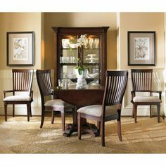 Abbott Place 5 pc. Round Drop Leaf Dining Set by Hooker Furniture Corporation. $1799.99. Your space may be small, but the Abbott Place 5 pc. Round Drop Leaf Dining Set is big on style. So functional and adaptable, this set comes with everything you need to set up the perfect dinner. The luxuriously warm cherry finish and hardwood and veneer construction mean this table will stick around for the long haul. Upholstered chairs provide comfortable seating, and the good looks are som...