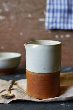 Half glazed terracotta jug