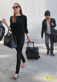 Angelina Jolie wearing Saint Laurent Chain and Leather Flat Sandals Saint Laurent Straight Leg Trousers in Black Louis Vuitton Capucines Taurillon leather bag Tom Ford Lydia FT 0228 Cat Eye Sunglasses Lands in Los Angeles with Maddox August 15 2013 Fashion Mode, Star Fashion, Fashion Photo, Ladies Fashion, Fashion Tips, Style Casual, Casual Outfits, Casual Chic, Angelina Jolie Style
