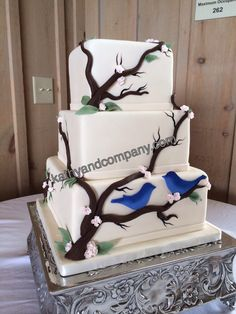 Tree branch wedding cake with sugar flowers and birds.