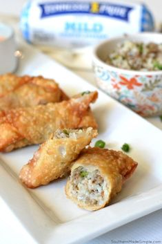 Are you ready for the ultimate appetizer to share with your friends and family? These Cajun Dirty Rice Egg Rolls with Creole Dipping Sauce are a delicious blend of Asian and Cajun cooking, and there's no fork required to enjoy them! Just grab a roll an Cajun Appetizers, Appetizer Recipes, Wonton Recipes, Snack Recipes, Snacks, Cajun Cooking, Cajun Food, Creole Sauce, Chicken Spring Rolls