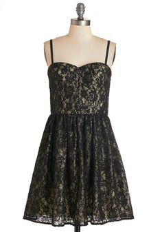 Admiring the Nightfall Dress. The view from the balcony tonight is stunning, and almost as beautiful as you feel in this black lace party dress! #gold #prom #modcloth