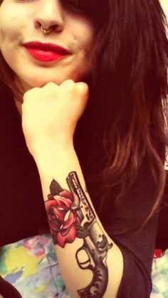 Gun and rose tattoo