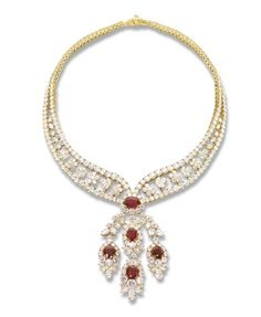 AN ELEGANT RUBY AND DIAMOND NECKLACE   The front designed as five cushion-shaped ruby and diamond clusters, the rubies weighing 3.11, 3.13, 3.66, 5.10 and 5.58 carats (a total weight of 20.58 carats) to the diamond graduating double line framing floral and foliate motifs, mounted in 18k yellow gold, 40.0 cm long. Late 20th century.