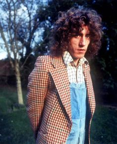 Roger Daltrey in houndstooth and overalls, 1977, via