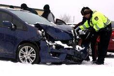 Officers look over a vehicle during a crash course Thursday.#tbay
