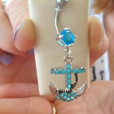 I hate dangly belly button rings, but I would actually consider getting this one. Gorgeous.