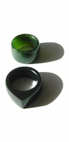 Jade womens rings.  The green wedding ring is made out of marbled NZ Jade. The black ring is made out of fine black Australian Jade. Jade is also called Pounamu / Greenstone in New Zealand. Carved by Aaron Brown,