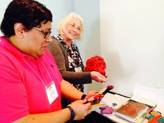 SOHA board members Carlos Lopez and Joyce Marshall Moore checking out a few of the Silent Auction items