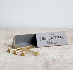 meet my new favorite thing: brass triangle-head nails!!
