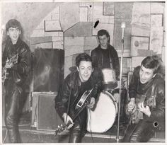 Beatles in action at the Cavern Club ca.1961. I would love to have been a fly on the wall when the Beatles played this club - how amazing to be part of that scene before they made it really big!!