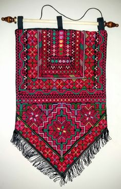 Beautiful Palestinian Bedouin embroidered wall hanging. The cross stitch embroidery is fully handmade by Bedouin women.  Width 32 cm x height 54 cm.  For more wall hangings see: https://sites.google.com/site/bedouinart/homing/wallhangings