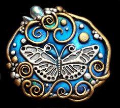Brooch made using cernit polymer clay, iridescent crystal droplets and PearlEx powdered pigment.