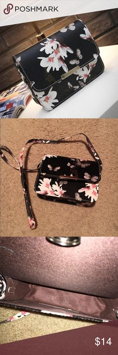 Simple butterfly purse Black purse with pink and white flowers with butterflies. Simple box like purse. No pockets inside or on the outside. Adjustable strap. Bags Crossbody Bags