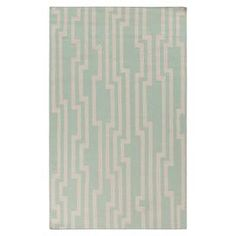 Beautifully handcrafted of wool, this chic rug from interior designer Candice Olson brings on-trend appeal to your den, dining room, or master suite.    Product: RugConstruction Material: 100% WoolColor: Pale aqua green and ivoryFeatures:  Hand-wovenMade in India Note: Please be aware that actual colors may vary from those shown on your screen. Accent rugs may also not show the entire pattern that the corresponding area rugs have.Cleaning and Care: Blot stains