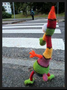 What a cutie! A walking yarnbombing...