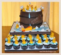 Baby shower rubber duckie cake and cupcakes