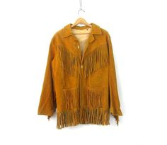 Stunning Western jacket! Brown suede leather and great fit. Leather fringe across the front and back of the jacket - sleeves too! Hand pockets and button closures (missing one). Throw this jacket on and hit the road.  MEASUREMENTS are taken w/ garments laying flat, across seam to