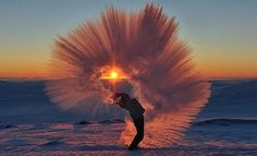 Stunning Image of Tea Flung Overhead Turning Into a Plume of Ice at Sunset in -40°C Weather
