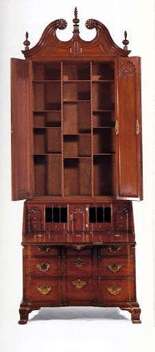 Newport, Rhode Island , block-and-shell-carved secretary, Goddard-Townsend. A secretary combines a desk with a storage unit for books and writing materials. There is a desk surface with a space for writing appliances which is combined with a drawer base below and a book case cabinet above. Chippendale secretaries have the same basic form as the Queen Anne, but are usually much larger and may be crowned by a massive cornice.