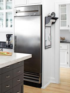 HGTV Magazine offers a peek inside the kitchen of caterer Peter Callahan. The cooking pro shares his kitchen design tips with organization ideas, timesaving tools and budget tricks. White Kitchen, Home, Remodel, Kitchen Remodel, Kitchen Design Pictures, Hgtv Kitchens, Kitchen Refrigerator, Attic Storage, Kitchen Design