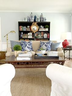 Decorating our living room with a few simple Christmas touches (Colonial house, black bookcases, blue and white, jute rug, sofa, light blue walls)
