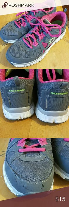 Ladies/girls Skechers running athletic sneakers Ladies/girls Skechers sport with Flex sole,  color is grey and hot pink with florescent green accent. Very nice condition with just a small scuff on the front right sneaker. These were worn by my wife for the gym and walking. Literally worn just a hand full of times. Prices to sell fast. Skechers Shoes Athletic Shoes