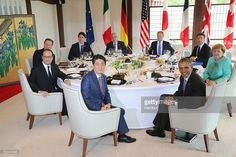 In this handout image provided by Foreign Ministry of Japan, (counter-clockwise from front C) Japanese Prime Minister Shinzo Abe, U.S. President Barack Obama, German Chancellor Angela Merkel, Italian Prime Minister Matteo Renzi, European Council President Donald Tusk, European Commission President Jean-Claude Juncker, Canadian Prime Minister Justin Trudeau, British Prime Minister David Cameron and French President Francois Hollande pose for a photo during the working lunch at the Shima…