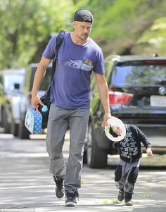 Doting dad: Josh Duhamel and son Axl went to the park in Brentwood California on Wednesday...