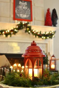 red lantern centerpiece on coffee table and Christmas mantel with chalkboard