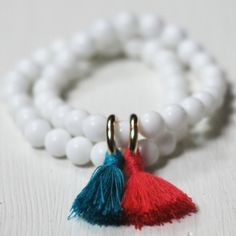 White Bracelet With Turquoise And Pink Tassels