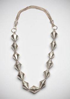"""Laurie Hall: Topsy Turvy, Fabricated sterling silver and sterling silver foxtail chain.  23"""" chain."""