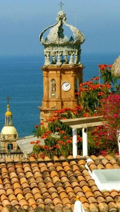 Puerto Vallarta, Mexico with it's tile roofs and cobbled streets - a treasure along the Pacific coast of Mexico!  ASPEN CREEK TRAVEL - karen@aspencreektravel.com