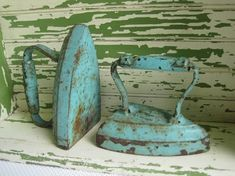 Antique Cast Iron Clothes Iron. I like the turquoise
