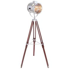 "LumiSource ""Ahoy"" Adjustable Floor Lamp Was $289.99 Now $200.51 The Ahoy Floor Lamp is truly stunning. This chrome spotlight features a wood tripod base, which adjusts from 44"" to 62"" H. The spotlight can be positioned to create the perfect accent lighting and will give any room in your house a maritime flair. Takes one 60-watt type A lightbulb which is not included. This Lamp ships in two boxes and requires easy assembly. Overall Product Dimensions: 30"" L x 30"" W x 62"" H; 10.5 lbs."
