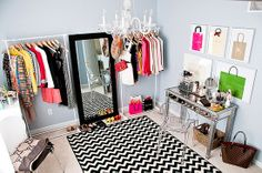 Small room turned closet w/ super cute framed shopping bags!