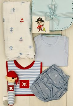 Ahoy Little Pirate - Boutique Baby Hamper with a cute Pirate theme. Hand squeaker, muslin wrap and nappy pants from Alimrose and singlet from Marquise. We stock only the very best Australian brands in our unique baby hampers. Baby Hamper, Baby Baskets, Pirate Baby, Pirate Theme, Anchor Print, Baby Boutique, Unique Baby, Nautical Theme