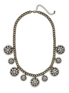 Advice From Jill Laine!  Glitzy and glamorous, this striking necklace works a party vibe à la Studio 54. $40 at Bauble Bar.