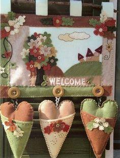 """Colgante """"Bienvenidos"""" con corazones"""
